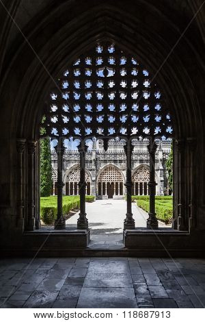 Batalha, Portugal - July, 2015: Back-lit effect of the tracery work on the Royal Cloister of the Batalha Abbey. Masterpiece of the Gothic and Manueline art. UNESCO World Heritage Site.