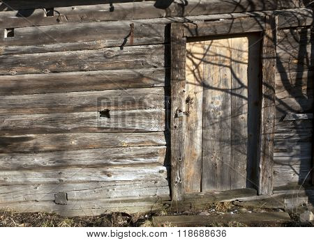 Old Log House With Closed Door.