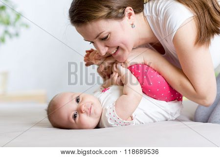 Mother and Baby having fun pastime together