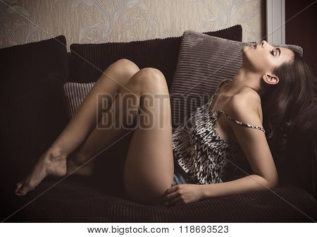 Erotic Brunette Girl On Sofa
