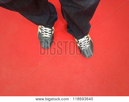 Close up of a man's feet on the red carpet. Red carpet welcome concept.