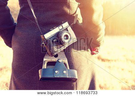 Girl With Retro Vintage Camera.