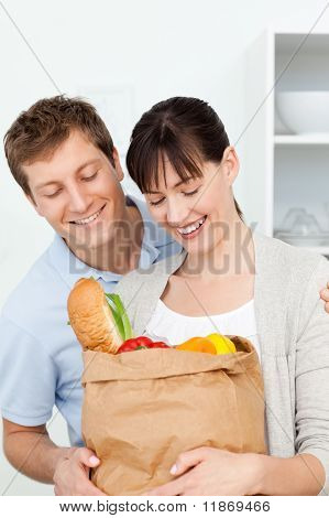 Adorable Pairs Looking At The Shoping Bags