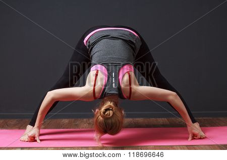 Yoga. Deep Bend With Straddled Legs. Woman Doing Workout.