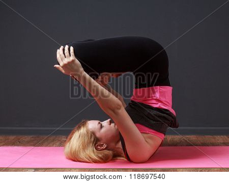 Yoga. Young Blonde Woman Doing Back Exercise