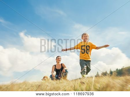 Boy Running On Golden Field