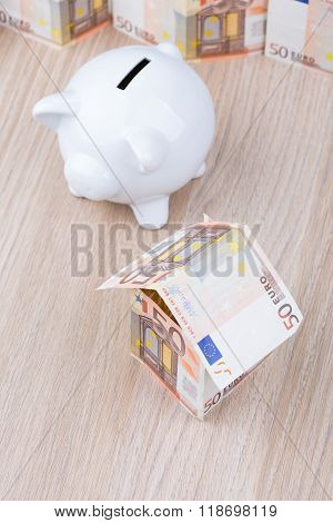 Bank note house with piggy bank