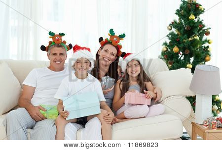Family During Christmas Day Looking At The Camera