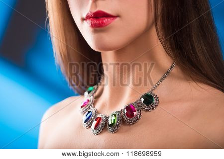 necklace on the neck. ruby and emerald