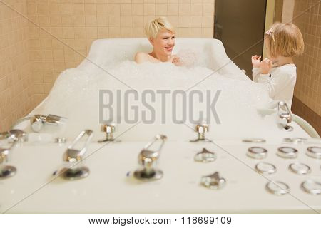 A woman and a hydro massage. She receives medical treatments for relaxation. ** Note: Shallow depth of field