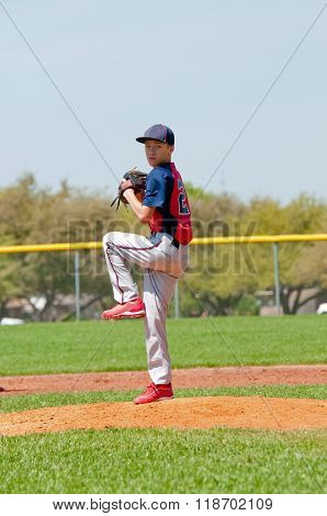 Baseball pitcher standing on the mound.
