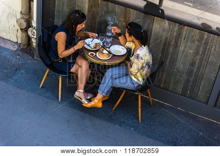 Parisians Enjoy Food And Drinks In Cafe