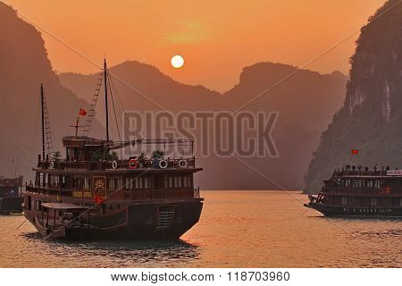 HALONG, VIETNAM - NOVEMBER 26, 2011:Sunrise at the Halong Bay on the west coast of northern Vietnam