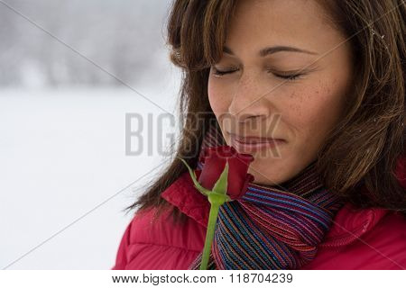 Mature woman smelling a rose