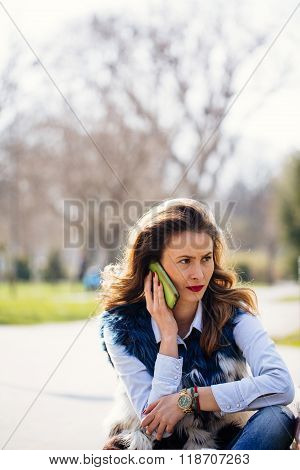 Concerned Girl Talking On Mobile Phone