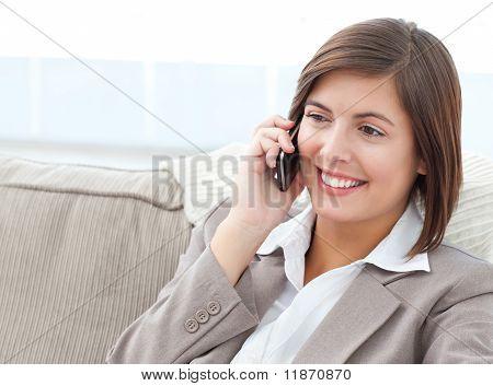 Smilng Businesswoman Phoning On Her Sofa