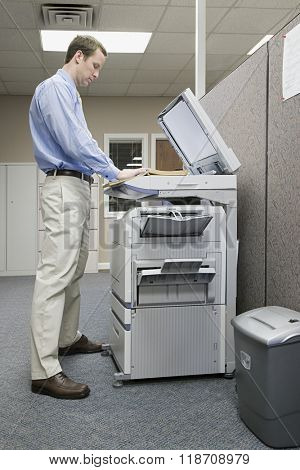 Office worker photocopying