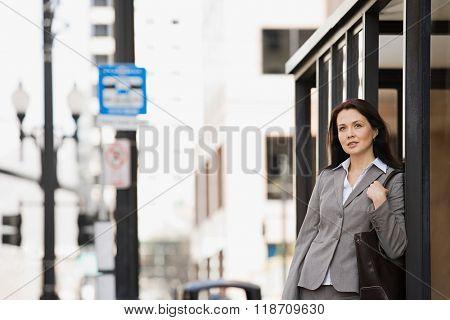 Woman waiting at bus stop