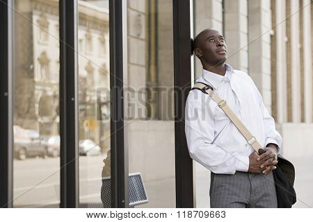 Man waiting at bus stop