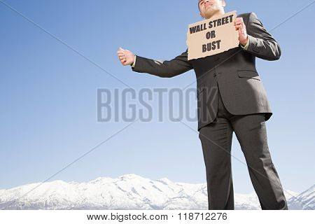 Businessman hitching a ride