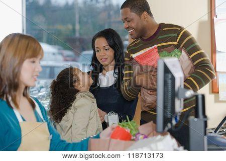 family at a till