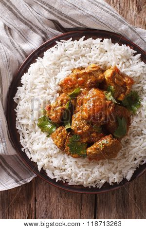 Beef Madras With Basmati Rice Close-up On A Plate. Vertical Top View