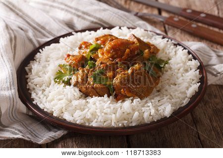 Traditional Beef Madras With Garnish Basmati Rice Close-up. Horizontal