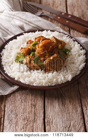 Beef Madras With Basmati Rice Close-up. Vertical