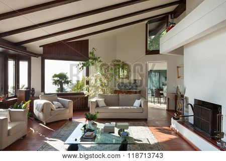 Interior; living room of a rustic house; divan and armchairs