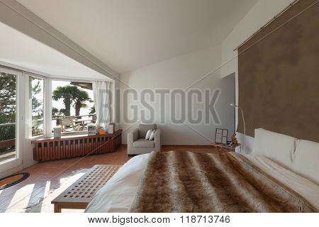 Interior of house, double bed with fur bedspread