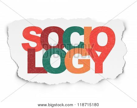 Learning concept: Sociology on Torn Paper background