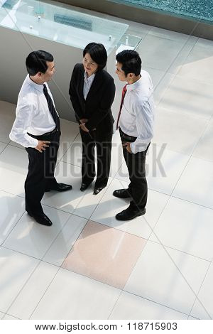 Elevated view of Chinese businesspeople