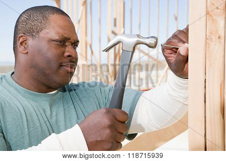 A man hitting a nail with a hammer