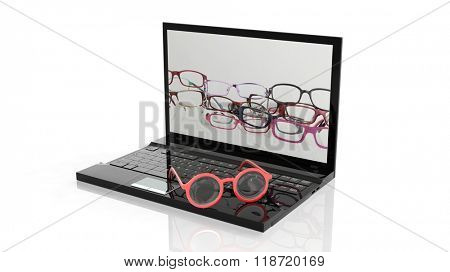 Eyeglasses set on laptop keyboard, and screen with various eyeglasses wallpaper, isolated on white