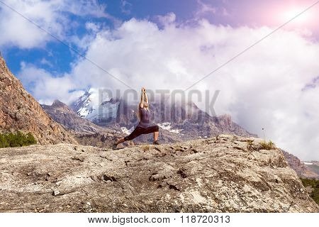 Attractive Young Woman Doing a Yoga Pose