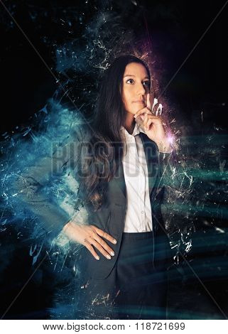 Three Quarter Length Portrait of Thoughtful Young Business Woman Wearing Suit Standing with Hand on Chin in front of Black Background with Graphic Overlay