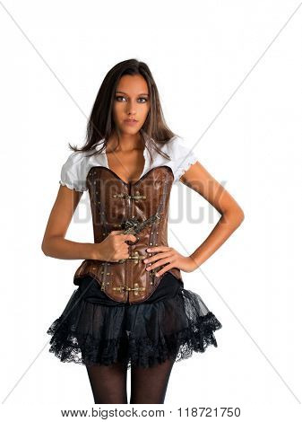 Three Quarter Length Portrait of Young Brunette Woman with Hand on Hip Wearing Western Themed Costume with Corset and Tutu and Holding Antique Pistol in Studio with White Background and Copy Space