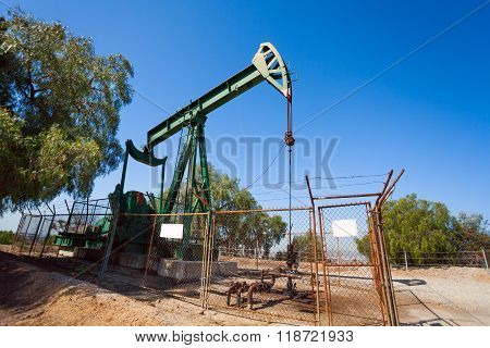 Pump jacks extract oil from an oilfield in USA
