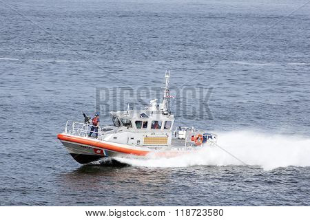 Fast Boat With Gunner Of U.s. Coast Guard