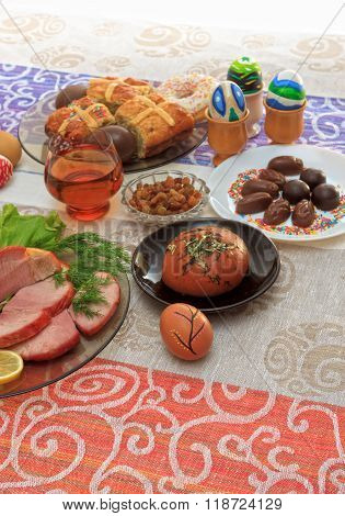 Traditional Easter Dinner Set With Sliced Meat With Lemon And Herbs, Bread, Handmade Colored Eggs, C