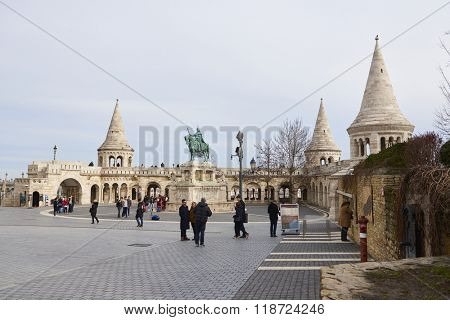 BUDAPEST, HUNGARY - FEBRUARY 02: Tourists walking around Fisherman's Bastion, with bronze statue of Saint Stephen in the Old Town district. February 02, 2016 in Budapest.