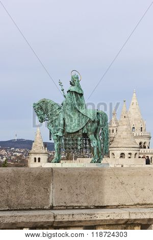 BUDAPEST, HUNGARY - FEBRUARY 02: Bronze statue of Saint Stephen, in the Old Town district, with Fisherman's Bastion spire in the background. February 02, 2016 in Budapest.