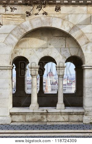 BUDAPEST, HUNGARY - FEBRUARY 02: Hungarian Parliament building seen from between Fisherman's Bastion's arches, at the Old Town district. February 02, 2016 in Budapest.