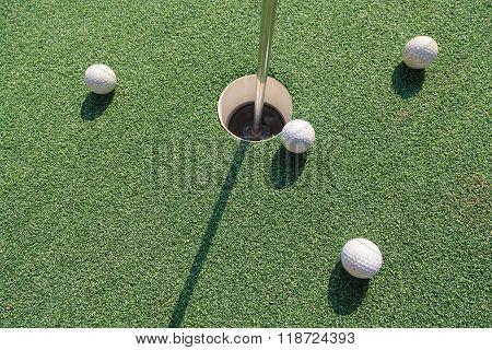Four Golf Balls