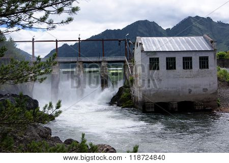 Old hydro power station on the mountain river