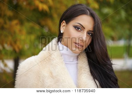 Oriental style. Sensual arabic woman model. Beautiful young girl in fur coat