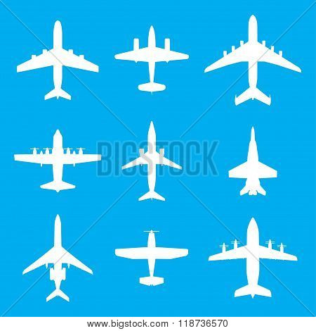 Airplane icons set. Vector white silhouettes of passenger aircraft, fighter plane and screw.