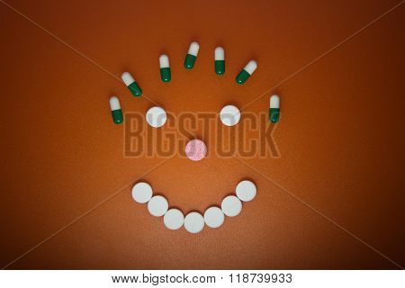 Tablets in the form of cheerful faces.