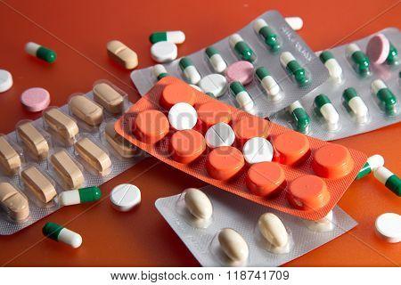 Medication on an orange background.