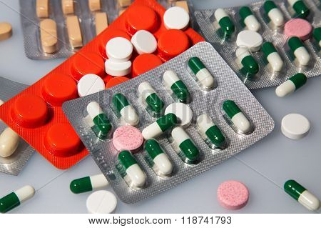 Many tablets and capsules.